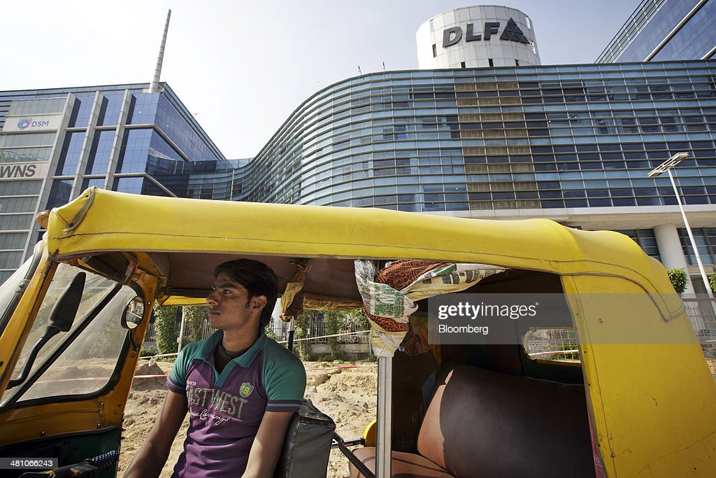 An auto rickshaw driver waits for customers outside DLF Cybercity, a 128 acre integrated business district, in Gurgaon, India, on Wednesday, March 26, 2014. Indian stocks rose, sending the benchmark index to a record, after the rupee rose to an eight-month high and sovereign bonds gained on speculation the worlds largest democracy will elect a government capable of reviving economic growth. Photographer: Kuni Takahashi/Bloomberg via Getty Images