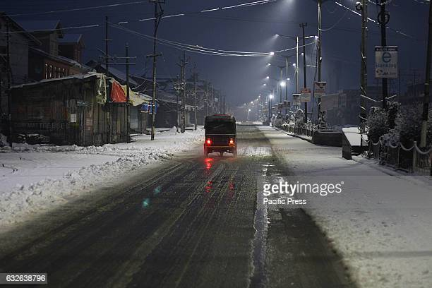 An auto rickshaw moves early morning after the fresh snowfall in Srinagar the summer capital of Indian controlled Kashmir on January 25 2017Normal...