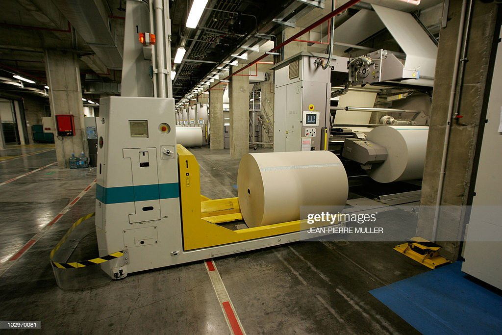 An automated paper distributor refills the rotary newspaper printing press machines in the basement of the French newspaper Sud-Ouest on February 19, 2008 in Bordeaux, southern France.