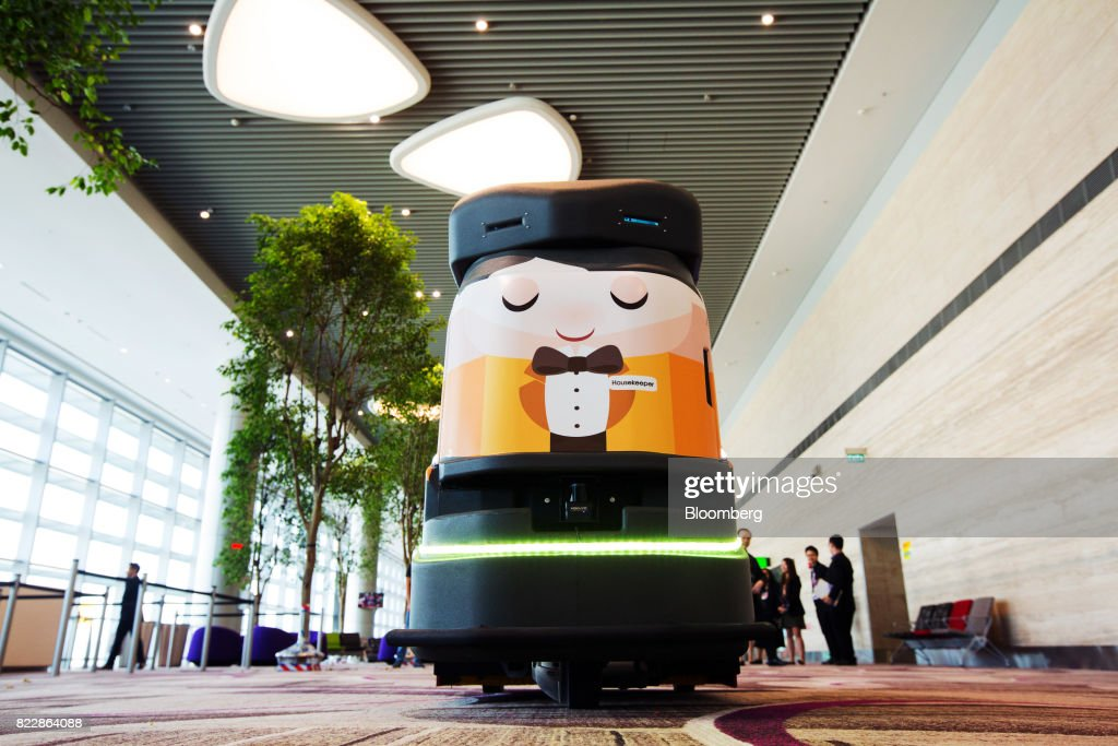An automated robotic cleaner travels along the departure hall during a media preview of the new Terminal 4 (T4) at Changi Airport in Singapore, on Tuesday, July 25, 2017. The terminal which will open later this year, will feature an array of fast and seamless travel (FAST) technologies to speed people-processing without the need for human supervision, from face-recognition software to automated bag-tagging and checking. Photographer: Nicky Loh/Bloomberg via Getty Images