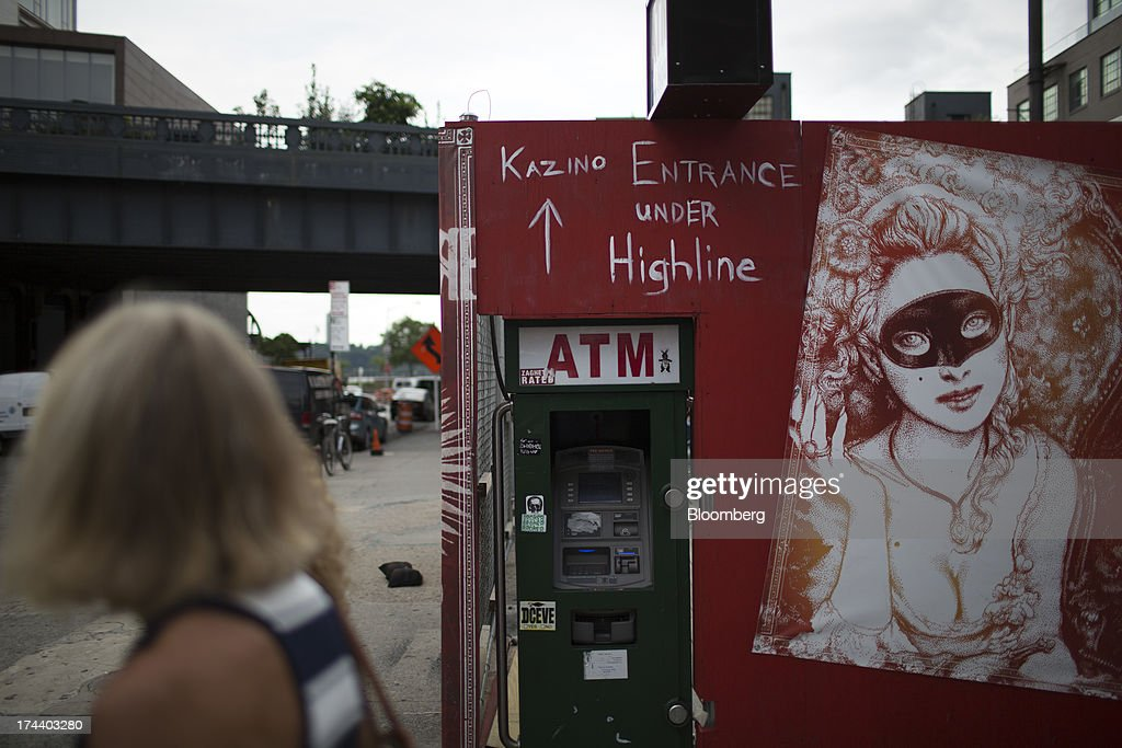 An automated teller machine (ATM) stands on a street corner in the meatpacking shopping district of New York, U.S., on Wednesday, July 24, 2013. The U.S. Conference Board is scheduled to release consumer confidence figures on July 30. Photographer: Scott Eells/Bloomberg via Getty Images