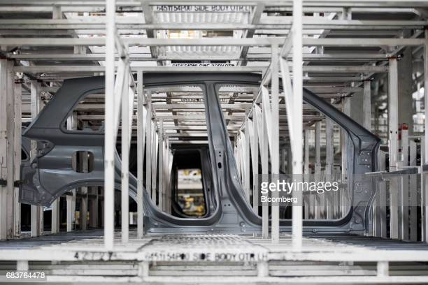 An automobile body frame panel stands on the production line inside the Suzuki Motor Corp plant in Esztergom Hungary on Monday May 15 2017 European...