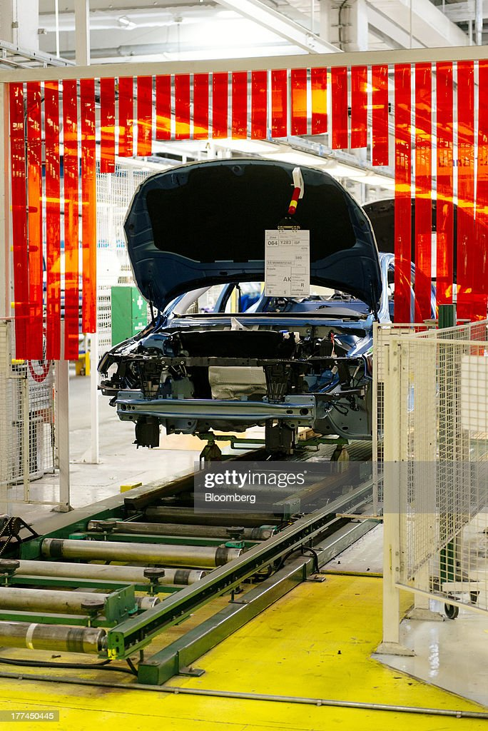 An automobile chassis moves along the automated production line at the Volvo Cars plant in Torslanda, Sweden, on Thursday, Aug. 22, 2013. Volvo Cars Chief Executive Officer Hakan Samuelsson will settle a German investigation into corruption allegations linked to his tenure as MAN SE's CEO by paying 500,000 euros ($668,000) to charity. Photographer: Kristian Helgesen/Bloomberg via Getty Images