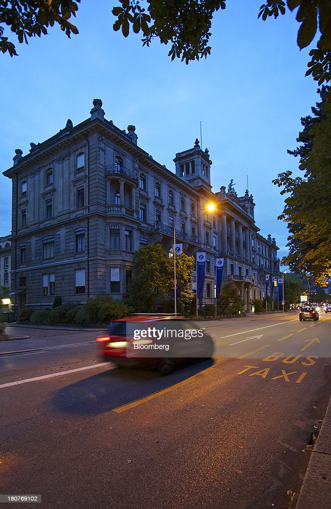 An automobile drives past Zurich Insurance Group AG's headquarters at dawn in Zurich, Switzerland, on Monday, Sept. 16, 2013. Zurich Insurance named Tom de Swaan chairman, replacing Josef Ackermann, who stepped down after the suicide of Chief Financial Officer Pierre Wauthier. Photographer: Gianluca Colla/Bloomberg via Getty Images