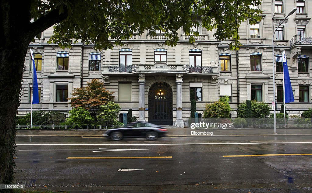 An automobile drives past Zurich Insurance Group AG's headquarters in Zurich, Switzerland, on Monday, Sept. 16, 2013. Zurich Insurance named Tom de Swaan chairman, replacing Josef Ackermann, who stepped down after the suicide of Chief Financial Officer Pierre Wauthier. Photographer: Gianluca Colla/Bloomberg via Getty Images