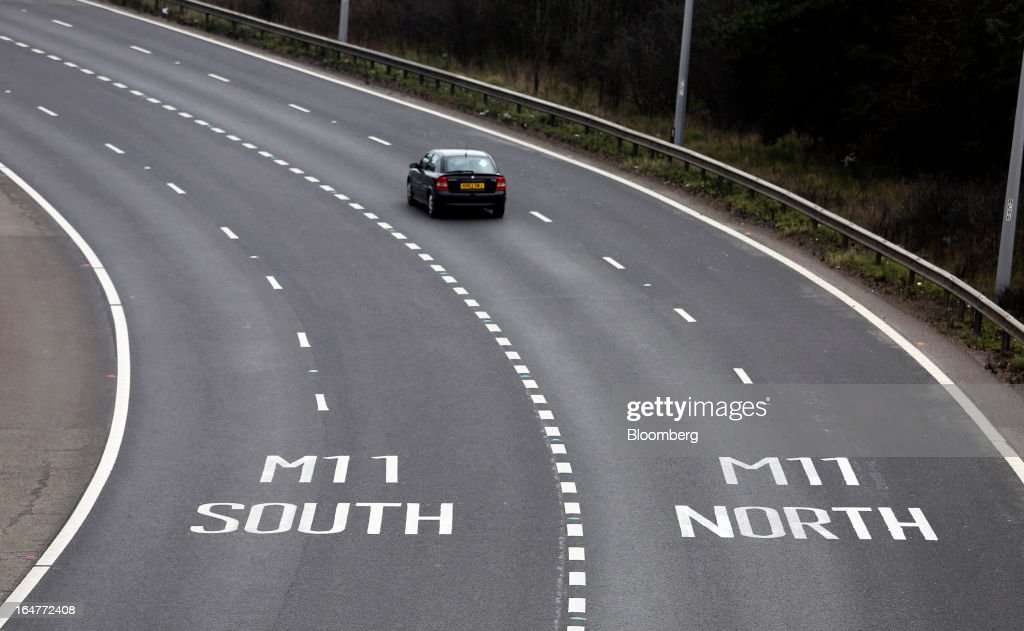 An automobile exits the M25 motorway and heads to join the M11 motorway towards London, U.K., on Wednesday, March 27, 2013. The U.K. government will increase spending on infrastructure projects, including road construction, by an annual 3 billion pounds ($4.6 billion) from 2015 as Chancellor George Osborne seeks to boost economic growth. Photographer: Chris Ratcliffe/Bloomberg via Getty Images