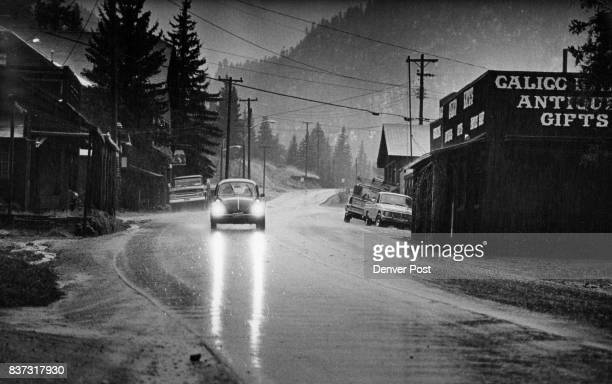 An automobile moves through the village of Glen Haven on the North Fork of Big Thompson River during a rainstorm that had caused some worry The area...