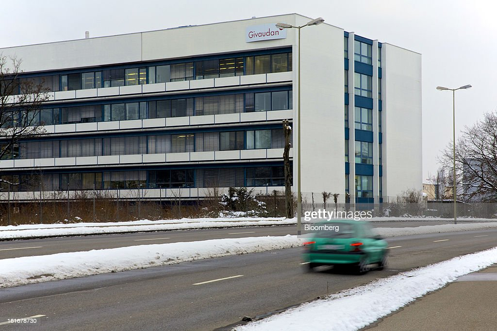 An automobile passes Givaudan SA's headquarters in Dubendorf, Switzerland, on Wednesday, Feb. 13, 2013. Givaudan SA, the world's largest maker of flavorings and fragrances, announced a bigger-than-estimated dividend after riding out a year of high raw-material prices and a strong Swiss franc. Photographer: Gianluca Colla/Bloomberg via Getty Images