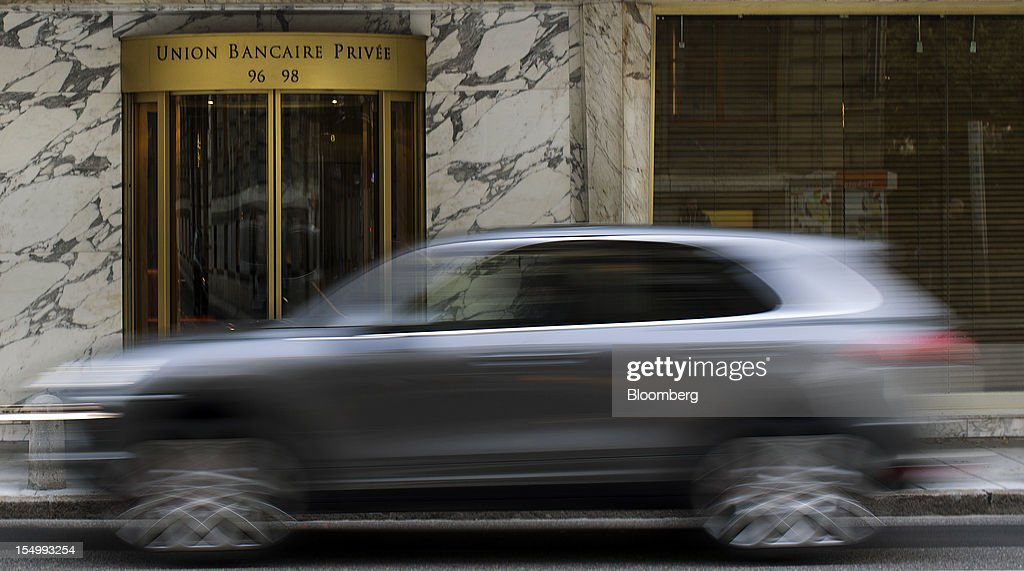 An automobile passes the entrance to the offices of Union Bancaire Privee (UBP), the Geneva-based wealth manager founded by Edgar de Picciotto in Geneva, Switzerland, on Monday, Oct. 29, 2012. Geneva's banks employed 502 fewer people at the end of June compared with a year earlier as foreign wealth managers cut jobs and shifted employees to other locations, a survey by the city's financial lobby group shows. Photographer: Valentin Flauraud/Bloomberg via Getty Images