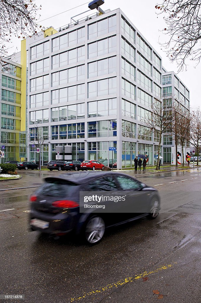 An automobile passes the offices of Holcim Ltd. in Zurich, Switzerland, on Thursday, Nov. 29, 2012. Holcim Ltd., the world's largest cement maker, is considering disposals as Fontana deals with a greater-than-expected slowdown in Europe. Photographer: Gianluca Colla/Bloomberg via Getty Images