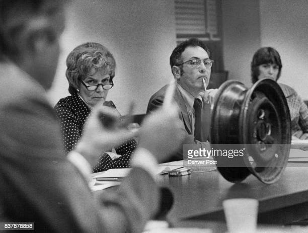 An automobile wheel is used as a visual aid while Rep Ted Bendelow DDenver foreground explains provisions of autorepair bill to other members of the...