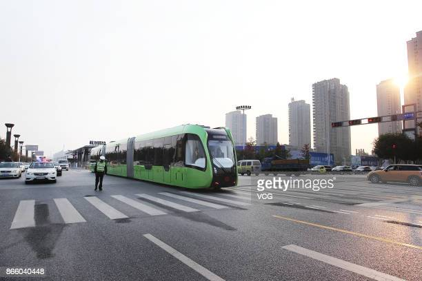 An autonomousrail train runs on road as a test on October 23 2017 in Zhuzhou Hunan Province of China The threecarriage railless train developed by...