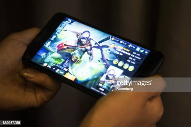 An avatar is displayed in an arranged photograph of the Honour of Kings mobile game developed by Tencent Holdings Ltd in Hong Kong China on Friday...