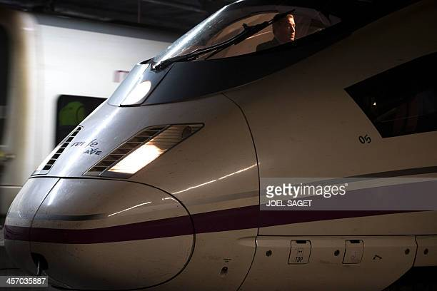 An AVE high speed train locomotive is pictured on December 15 2013 at Barcelona's train station during the inaugural trip of a direct fast train line...