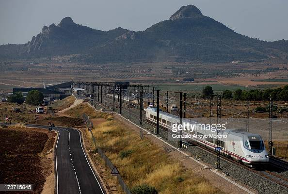 An AVE the Spanish high speed train leaves the station towards Madrid on July 11 2013 in Villena Spain The AVE MadridAlicante highspeed train route...