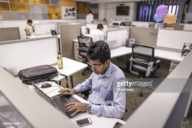 An Avendus Capital Pvt employee works on a laptop computer at the company's office in Mumbai India on Monday Oct 26 2015 Avendus Head of Technology...
