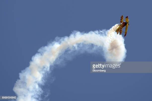 An Aviat Aircraft Inc Pitts Special S2S biplane performs maneuvers during an aerobatic flying display at the Australian International Airshow held at...