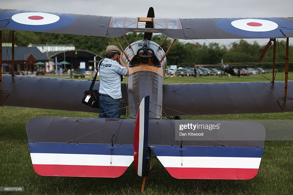 An aviation enthusiast takes a photograph of Sopwith Pup at 'The Shuttlesworth Collection' on July 21, 2014 in Biggleswade, England. Of the 55,000 planes that were manufactured by the Royal Army Corps (RAC) during WWI, only around 20 remain in airworthy condition. Six of these belong to The Shuttleworth Collection at Old Warden, Bedfordshire, making it the most complete collection of original airworthy WWI aircraft in the world. Amongst the collection is the SE5a. The SE5a is a single seater fighter aircraft. It is an original biplane designed by the Royal Aircraft Factory, with its engine built by Wolseley Motors Ltd, and it was issued to 84 Squadron in November 1918. The National Archive in Kew has recently verified that the plane saw action in France with 84 Squadron the day before Armistice, November 10, 1918.