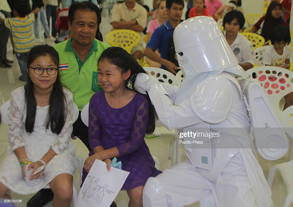 An avid fan of Star Wars in Storm troopers costume, one of the characters in the epic science fiction movie Star Wars held special event with a gift giving that brings smile to a child at Queen Sirikit National Institute of Child Health.