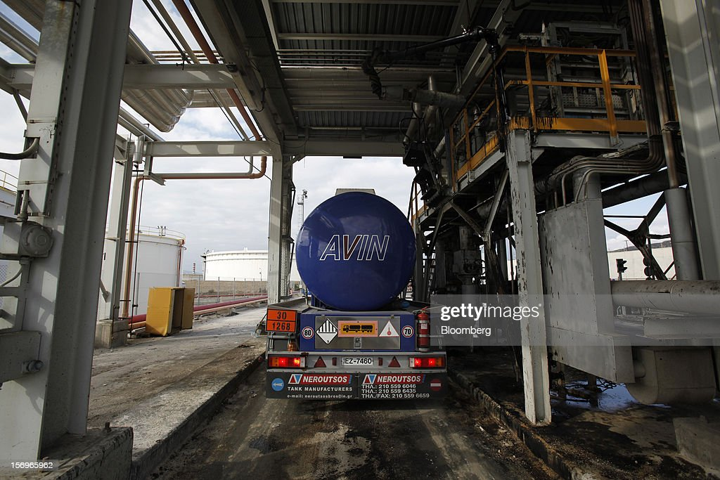An AvinOil SA transporter truck stands at a filling point inside the Motor Oil Hellas SA oil refinery in Agioi Theodoroi, Greece, on Friday, Nov. 23, 2012. Motor Oil Hellas SA Chief Financial Officer Petros Tzanetakis said Greek companies face difficulties in securing financing as foreign banks look at Greece with a 'skeptical eye.' Photographer: Kostas Tsironis/Bloomberg via Getty Images