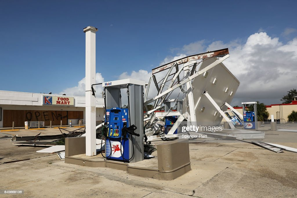 An awning is shown destroyed at a gas station the morning after Hurricane Irma swept through the area on September 11, 2017 in Naples, Florida. Hurricane Irma made another landfall near Naples yesterday after inundating the Florida Keys. Electricity was out in much of the region with localized flooding.