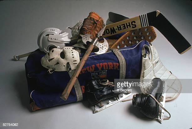 An axe laid over the goaltending equipment of Canadian professional hockey player Eddie Giacomin in a New York Rangers duffle bag 1974 The equipment...