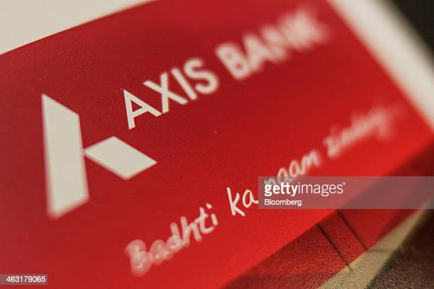 An Axis Bank Ltd brochure sits inside a bank branch in Mumbai India on Thursday Jan 16 2014 Axis Bank said net income in the third quarter rose 19...