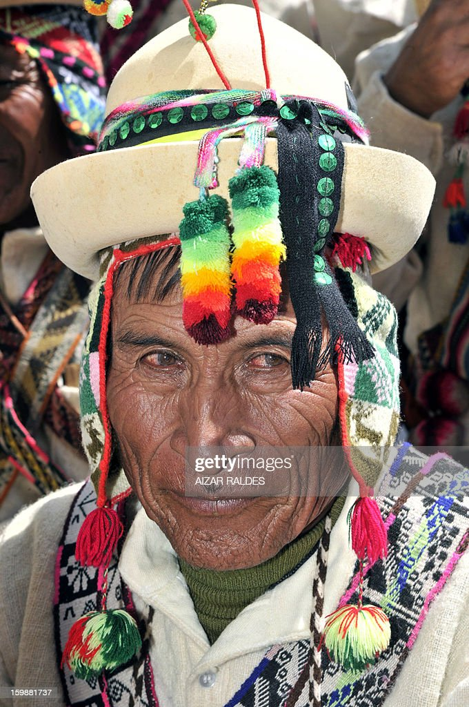 An Aymara indigenous peasant attends celebrations for the third anniversary of the Plurinational State of Bolivia outside Quemado palace in La Paz, on January 22, 2013. AFP PHOTO /Aizar Raldes