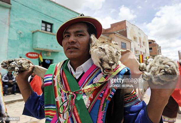 An Aymara native takes part in a parade held after a ritual ceremony for reelected Bolivian President Evo Morales along the streets of the town of...