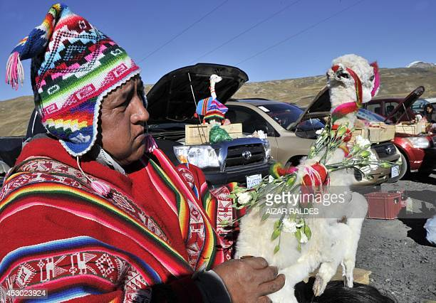 An Aymara yatiri performs a ritual to the Pachamama on August 1 2014 in La Cumbre 25 km from La Paz Bolivians will pay homage to the Pachamama during...