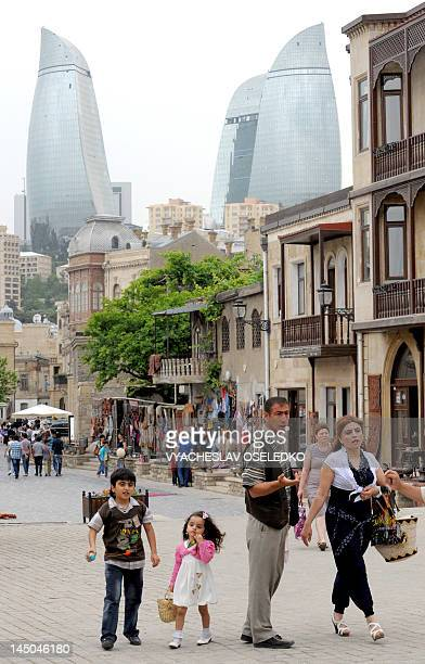An Azerbaijani family walks in the capital Baku on May 22 2012 Locals prefer to see the Eurovision competition as a chance to put their city which...
