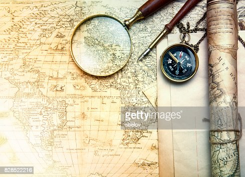 An brass compass on a old map background : Stock Photo