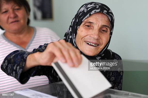 An Bulgarian woman casts her vote during the Bulgarian general elections at a polling station in Edirne on July 5 2009 Polling stations opened in...