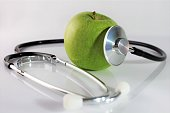 An concept image of a apple and a stethoscope