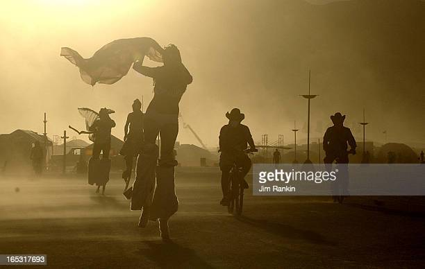DESERT NV An daylong windstorm whips sand as fine as talcum powder at Burning Man as participants take evening bike rides and strolls on stilts About...