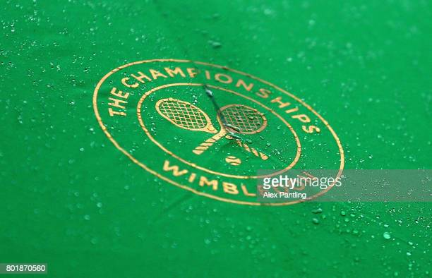 An detailed view as rain drops fall onto an umbrella during a rain delay at the 2017 Wimbledon qualifying session on June 27 2017 in London England