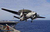 An E-2C Hawkeye launches from USS Kitty Hawk.