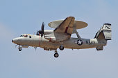An E-2D Advanced Hawkeye of the U.S. Navy in flight over the Pacific coast of California.