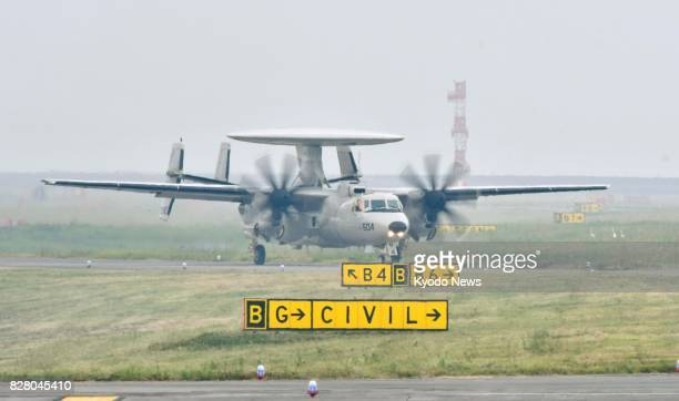 An E2D early warning aircraft lands at Marine Corps Air Station Iwakuni in the western Japanese prefecture of Yamaguchi on Aug 9 2017 Four other E2D...