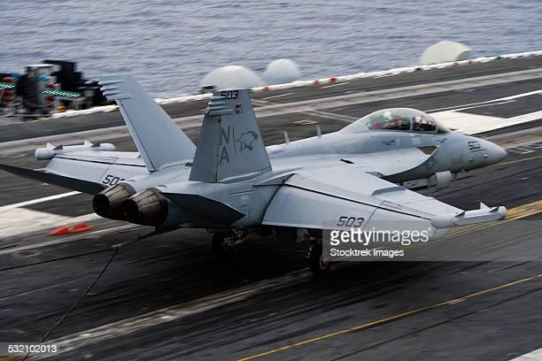 An EA-18G Growler lands on the flight deck of USS Carl Vinson.