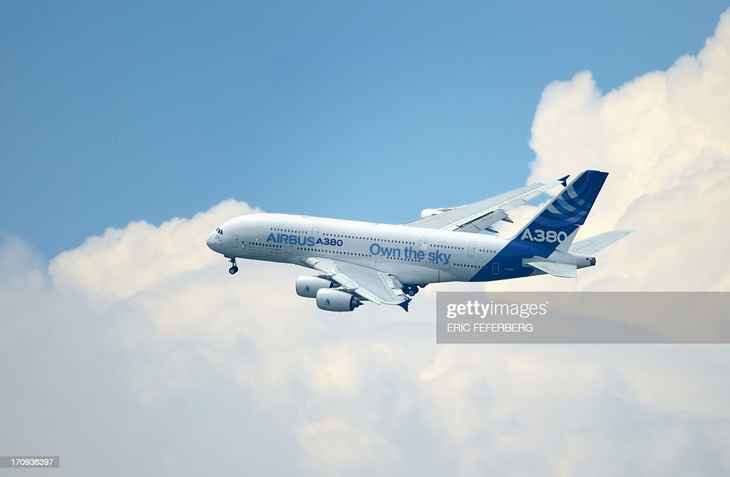 An EADS Airbus A380 flies over Le Bourget airport, near Paris on June 20, 2013 during the 50th International Paris Air show.