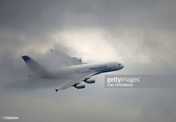 An EADS Airbus A380 flies over Le Bourget airport near Paris on June 20 2013 during the 50th International Paris Air show AFP PHOTO / ERIC FEFERBERG