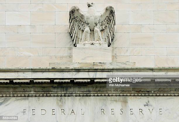 An eagle adorns the fascade of the US Federal Reserve building August 9 2005 in Washington DC The Federal Reserve is expected to raise shortterm...