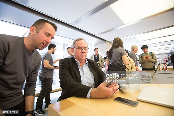 An early arriver gets his hands on the iPhone 6s at Apple Store on September 25 2015 in Sydney Australia Some eager iPhone fans arrived to queue at...