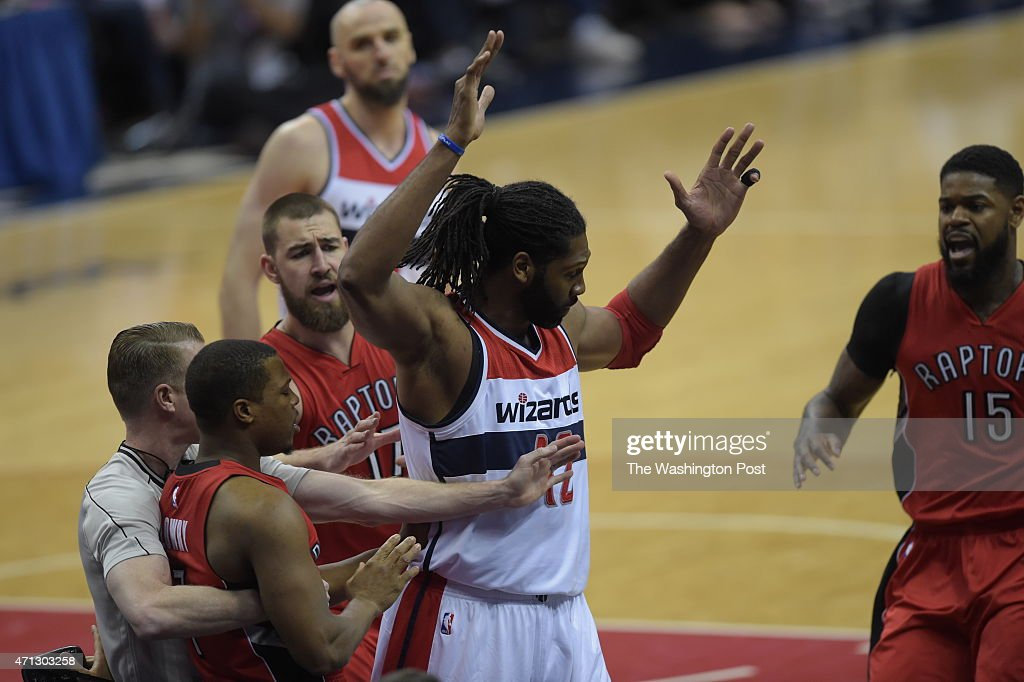 An early first-quarter dustup between Washington Wizards forward <a gi-track='captionPersonalityLinkClicked' href=/galleries/search?phrase=Nene+Hilario+-+Basketball+Player&family=editorial&specificpeople=4250456 ng-click='$event.stopPropagation()'>Nene Hilario</a> (42) and Toronto Raptors guard <a gi-track='captionPersonalityLinkClicked' href=/galleries/search?phrase=Kyle+Lowry&family=editorial&specificpeople=714625 ng-click='$event.stopPropagation()'>Kyle Lowry</a> (7) as Lowry is held back by an official during Game 4 of the Eastern Conference Quarterfinals between the Washington Wizards and the Toronto Raptors at the Verizon Center on Sunday, April 26, 2015.