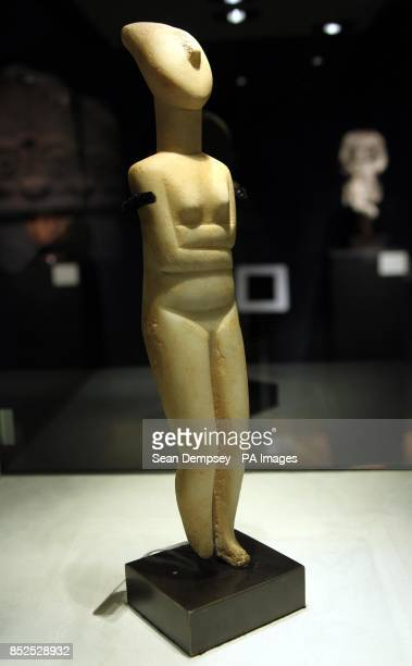 An early Greek Cycladic marble reclining female with an estimate of 120000180000 which is part of a collection of antiquities called the Origins of...