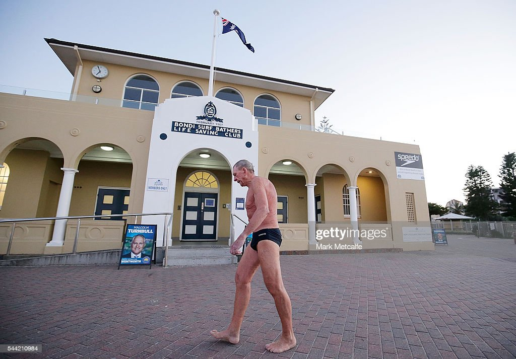An early morning swimmer past election posters at Bondi Beach in the electorate of Wentworth on July 2, 2016 in Sydney, Australia. Voters head to the polls today to elect the 45th parliament of Australia.
