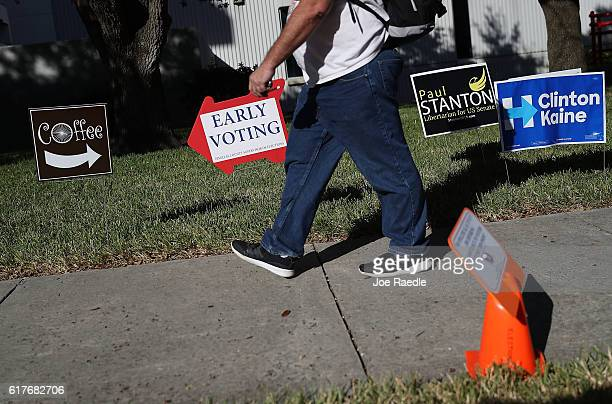 An early voting sign points voters to the polling station at the Pinellas County Election Services office on October 24 2016 in St Petersburg Florida...