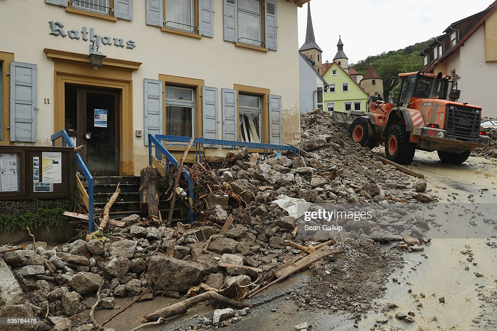 An earth mover collects boulders and other debris that cover a street in the village center next to the Town Hall following a furious flash flood the night before on May 30, 2016 in Braunsbach, Germany. The flood tore through Braunsbach, crushing cars, ripping corners of houses and flooding homes during a storm that hit southwestern Germany. Miraculously no one in Braunsbach was killed, though three people died as a result of the storm in other parts of the country.