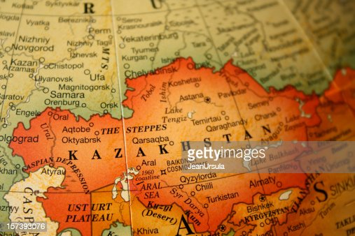 An earth tone political map focused on Kazakhstan